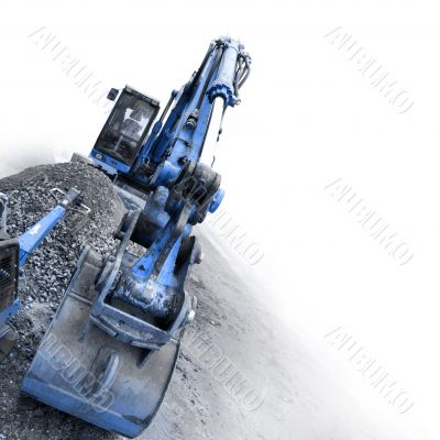 backhoe digging small stones