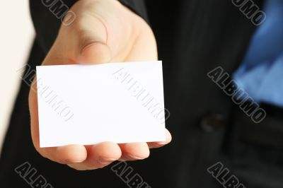card presented by a business man