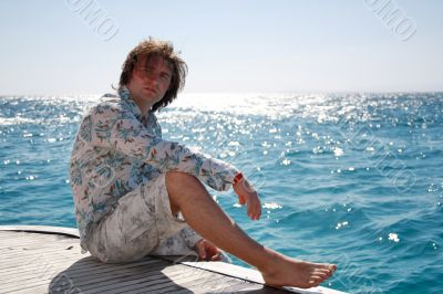 Man posing on the yacht