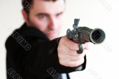 young man with gun