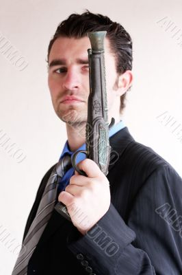 Businessman with ancient weapon