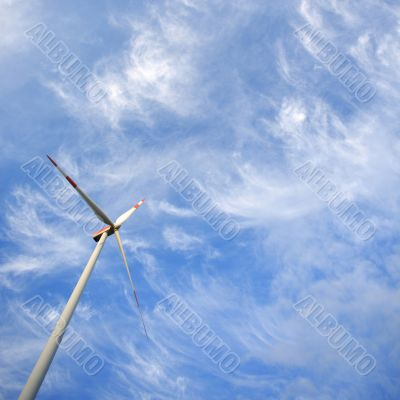 Windmill against blue sky with copy space