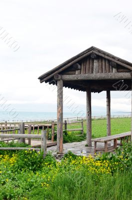 Wooden pavilion and fence in the grassland