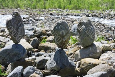 Balanced stones near the caucasus mountain river
