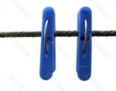 Blue clothes peg and string on the white background isolated