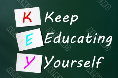 KEY acronym -Keep educating yourself on a blackboard with sticky notes