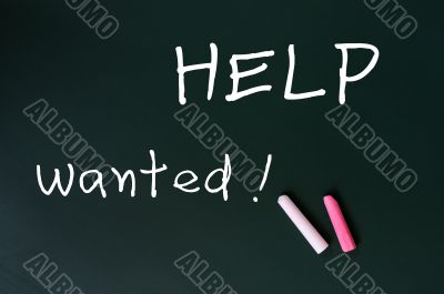 Help wanted - written with chalk on a green chalkboard background