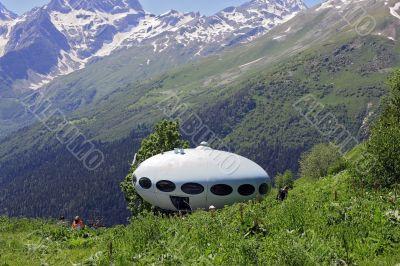 People around UFO that landing between caucasus mountains