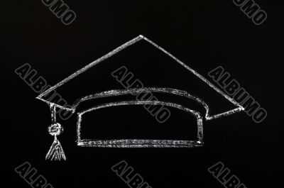 Trencher cap drawn with chalk on blackboard background
