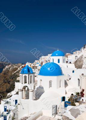 Famous Santorini churches vertical