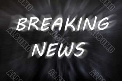 Breaking news written with motion rays on retro blackboard background