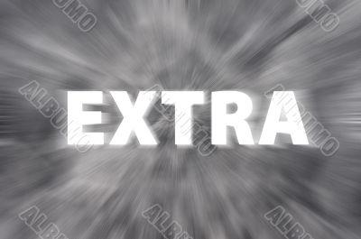 Chalk drawing of `Extra` word written on blurred chalkboard