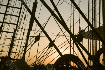 Ship`s rigging in the sunset
