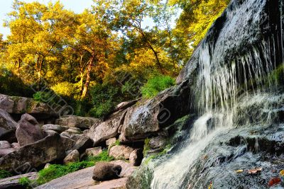 Falls among the rocks and autumn trees