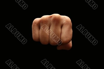 A man fist isolated on black background