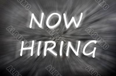Chalk drawing of Now hiring on a blurred blackboard
