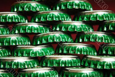 pile of green beer caps