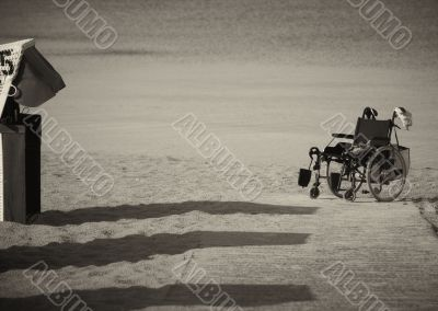 Wheelchair parked on the edge of sand