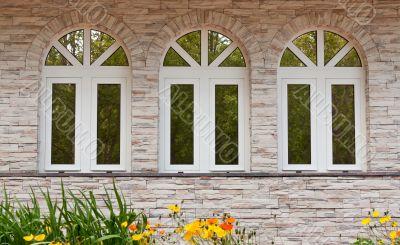 Three windows in the stone wall