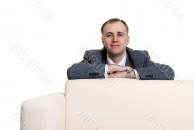 businessman looking out over the sofa