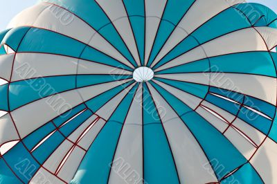 striped blue with a white parachute