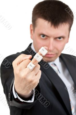 businessman shows Fuck. On the finger keys Ctrl Alt Del