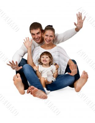 father, mother, daughter, sitting in the studio