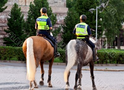 Two girls policeman on a horse