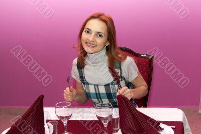 Beautiful girl in a restaurant