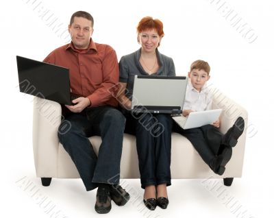 dad mom and son with laptop