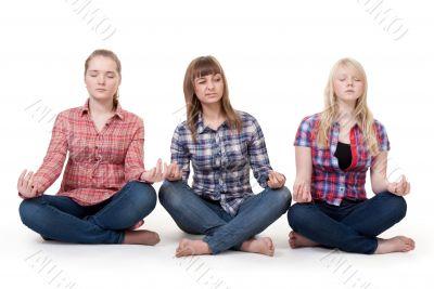 Three girls sitting in lotus posture