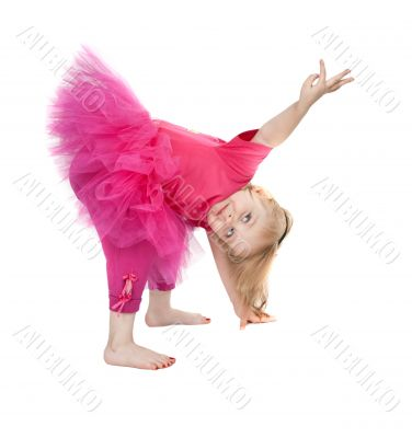 little girl in a pink dress dancing in the studio bow