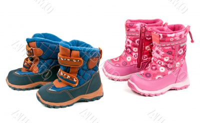 Two pairs of baby blue and pink boots