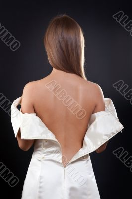 pretty girl with bare back in the studio