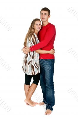 girl hugging a guy in a red dress in the studio