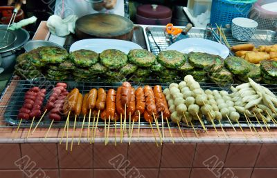 Asian street food tray with skewers