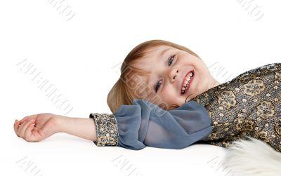 little girl lying on the floor in the studio