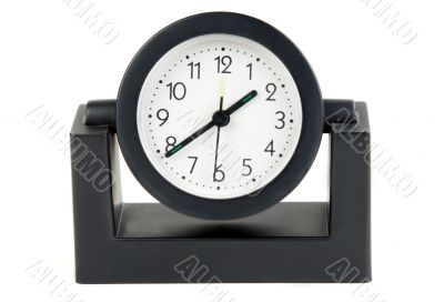 Desktops mechanical clock in a black plastic casing