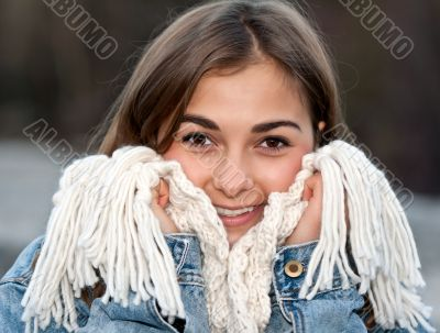 portrait of a girl wrapped in a warm scarf
