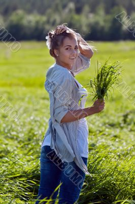 girl with a bundle of green grass