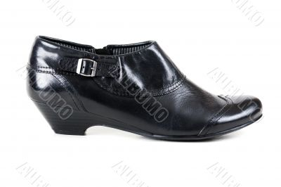 one black leather women`s shoes