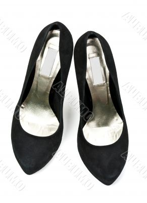 pair of black suede women`s high heel shoes