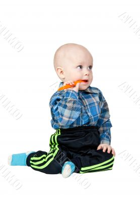A small child with an orange spoon
