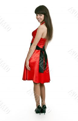 Woman in red dress turned back
