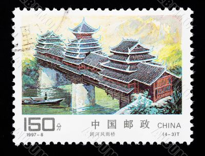 CHINA - CIRCA 1997: A Stamp printed in China shows a traditional covered bridge, circa 1997
