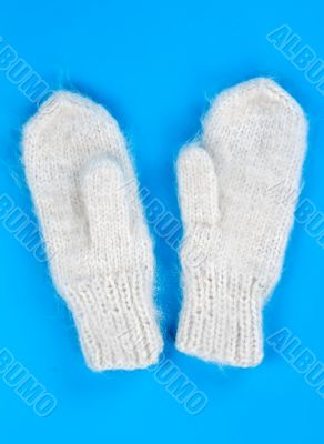a pair of knitted wool mittens