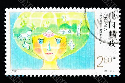 CHINA - CIRCA 2000: A Stamp printed in China shows the earth becoming younger, circa 2000