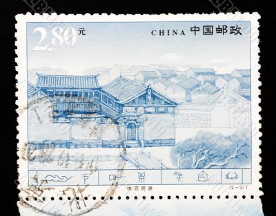 CHINA - CIRCA 2002: A Stamp printed in China shows the famous Naxi dwellings in Lijiang Yunnan, circa 2002