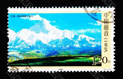 CHINA - CIRCA 2007: A Stamp printed in China shows Mount GONGGA in Sichuan China, circa 2007