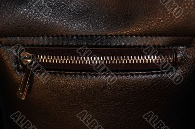 Zipper on dark brown leather hand bag